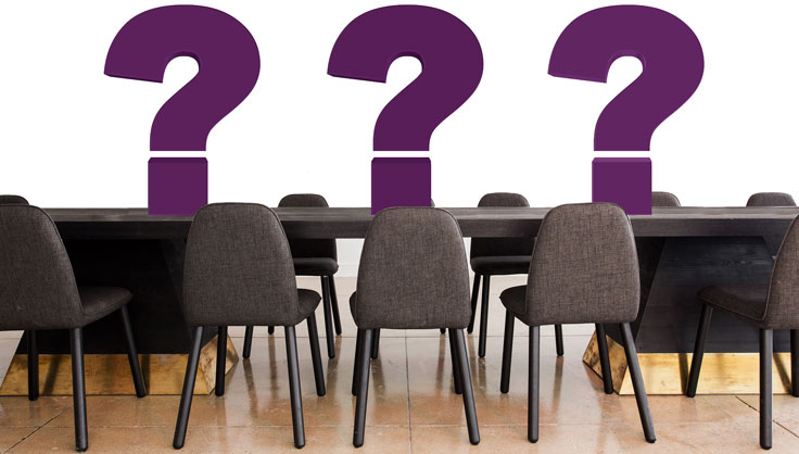 question marks on conference table.