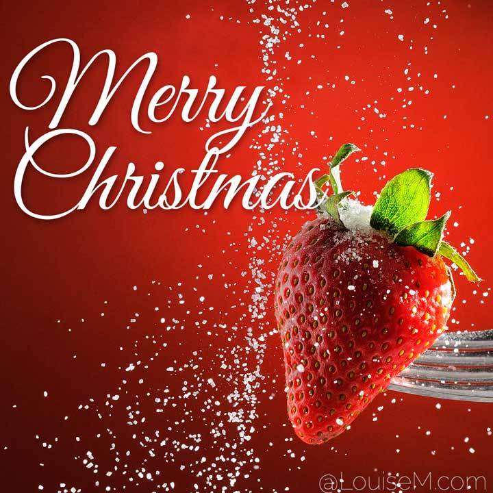 merry christmas script on red strawberry with sugar snow.