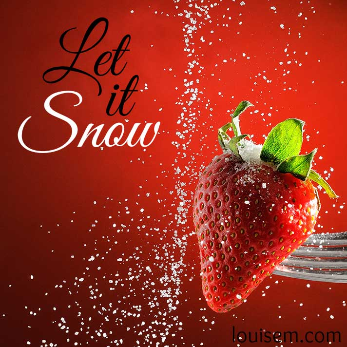 let it snow quote on red strawberry background.
