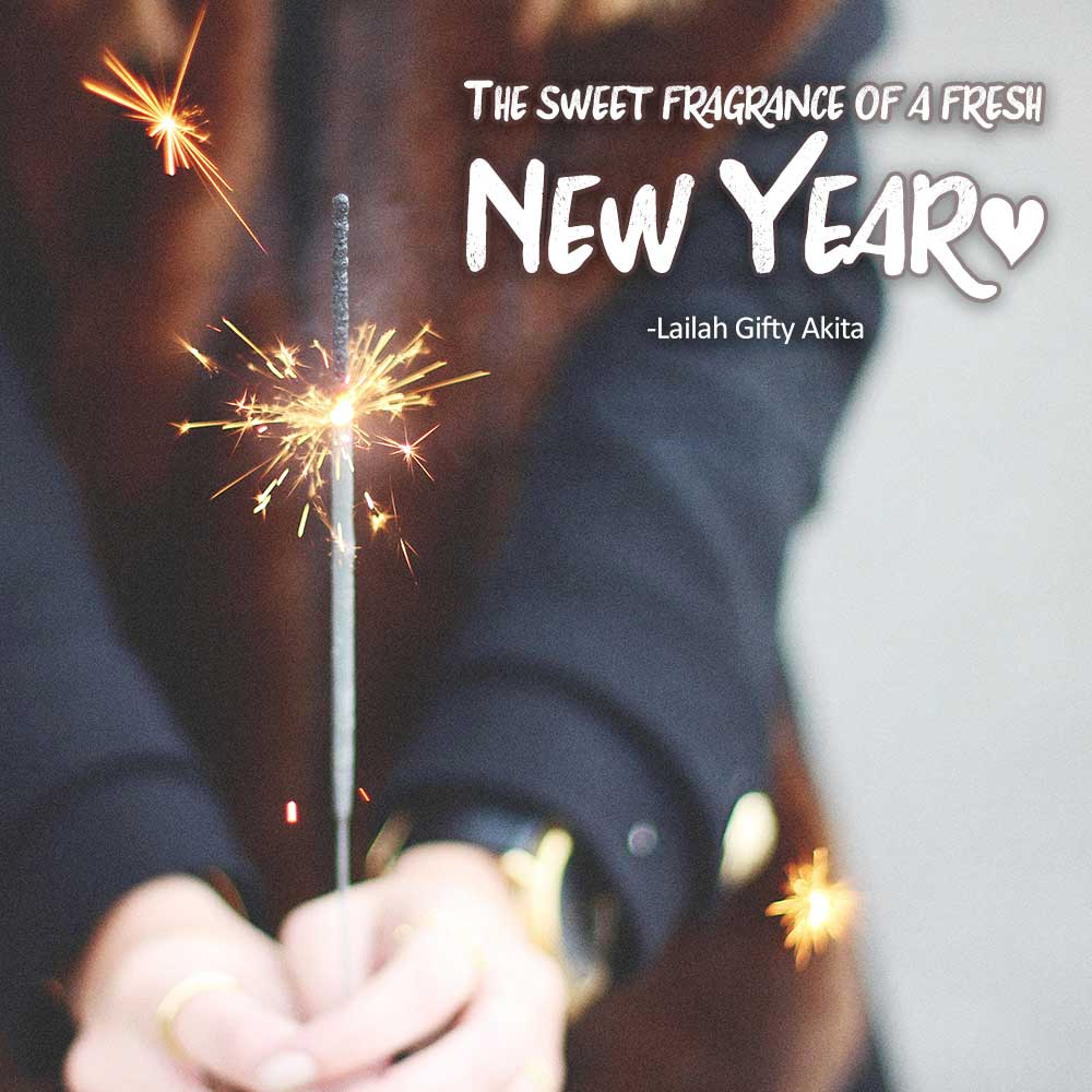 sweet fragrance of a fresh new year quote with woman in coat holding sparkler.