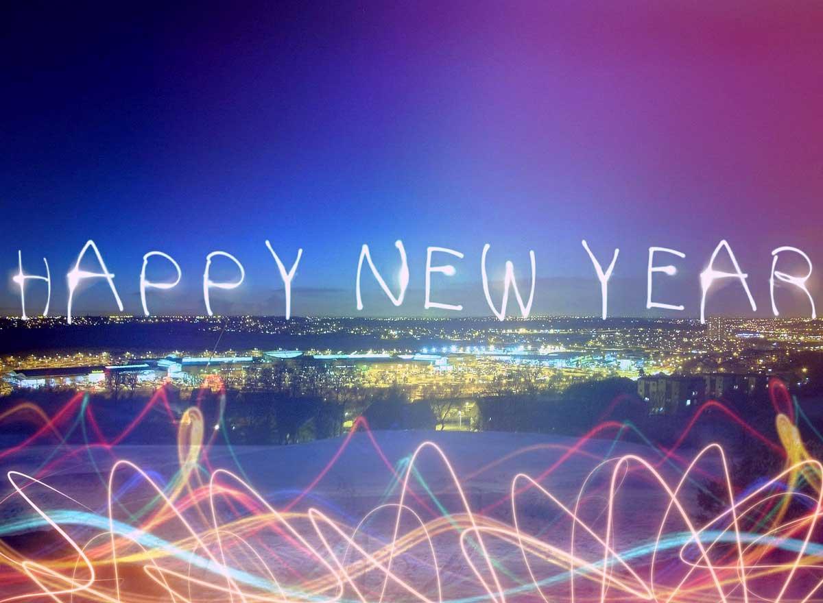 photo of happy new year written in light.